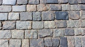 Beschaffenheit des rauen Steins auf der Straße Stockfoto