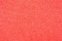 Beschaffenheit des roten Schaumgummigummis Stockfoto