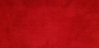 Beschaffenheit des roten Teppichs und Hintergrunddetail Stockfotografie