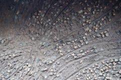 Beschaffenheit des Steins auf Lehmwand der traditionellen Hütte, Südafrika Stockfotos