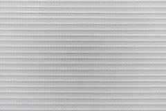 Beschaffenheit des weißen harten Plastikgitters, abstrakter Musterhintergrund stockbild