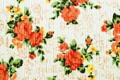 Beschaffenheit, Druck und wale des orange Blumenmusters des Gewebes Stockfotos