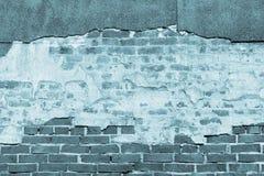 Beschaffenheit einer alten blauen Backsteinmauer mit zerstörtem Gips Lizenzfreie Stockbilder