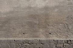 Beschaffenheit einer alten Wand von einem Steinziegelstein Stockfoto