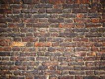 Beschaffenheit einer Backsteinmauer als Hintergrund, Schmutzoberfläche mit einem vin Lizenzfreie Stockbilder