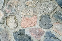 Beschaffenheit einer grauen Steinwand Steinwand der alten Wand als Hintergrund Teil einer Steinwand, für einen Hintergrund Stockbild