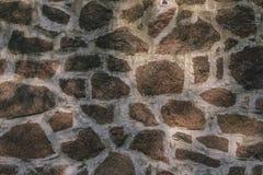 Beschaffenheit einer Wand vom verschiedenen Stein blockiert die Schaffung eines Musters, Stockfoto