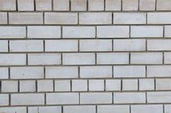 Beschaffenheit einer weißen Backsteinmauer Stockfotos