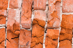 Beschaffenheit eines alten roten Backsteins Stockbild