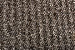 Beschaffenheit eines einfachen Teppichs Grauer Hintergrund stockbild