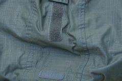 Beschaffenheit eines grünen Stoffes von einem Kleidungsstück Lizenzfreie Stockfotos