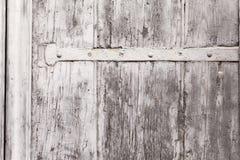 Beschaffenheit eines verwitterten hölzernen Fenster-Fensterladens Stockfotografie