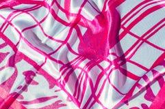 Beschaffenheit, Gewebe, Hintergrund Beschaffenheit eines weiblichen Kleides mit einem a Lizenzfreie Stockbilder