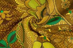Beschaffenheit, Gewebe mit einem Farbmuster, braune grüne Blumen flor Stockfotos