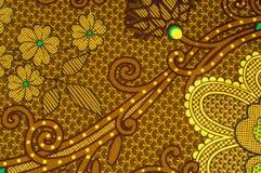 Beschaffenheit, Gewebe mit einem Farbmuster, braune grüne Blumen flor Lizenzfreies Stockfoto