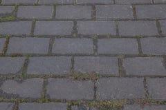 Beschaffenheit, Hintergrund Die Pflasterung des Granitsteins Gepflasterte Fahrbahnstraße irgendein gepflasterter Bereich oder Obe Stockfotografie