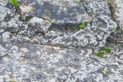 Beschaffenheit, Hintergrund, Muster alte Granitsteine Ein alter Stein w Lizenzfreies Stockbild