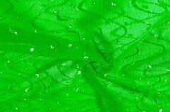 Beschaffenheit, Hintergrund, Mustermädchenkleid seide Grün-Silber mit Stockfotografie