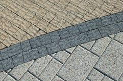 Beschaffenheit mit drei Artenplasterungs-Ziegelsteinen Stockbild