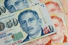 Beschaffenheit mit 50 und 10 Singapur-Dollarscheinen Stockbild