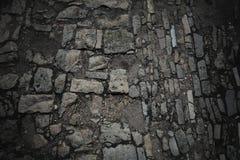 Beschaffenheit oder Hintergrund Alte Straße gepflastert mit Steinen Hintergrund, Beschaffenheit von Steinen und Flusssteine Lizenzfreies Stockfoto