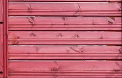 Beschaffenheit, rote hölzerne Latten Zaun stockfoto