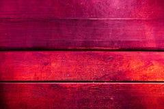 Beschaffenheit von alten hölzernen Planken mit gebrochener und geschmierter Farbe Stockfotografie