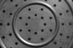 Beschaffenheit von Bohrlöchern der Stahlplatte in einem Kreis Stockbilder