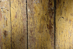 Beschaffenheit von den gebrochenen Holzverkleidungen bedeckt mit abgezogener Farbe Lizenzfreies Stockfoto