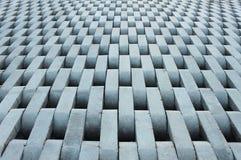 Beschaffenheit von den grauen konkreten Ziegelsteinen. Stockfoto