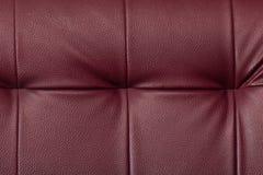 Beschaffenheit von roten ledernen Möbeln des Paprikas Lizenzfreie Stockfotos