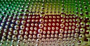 Beschaffenheit von silbernen Blasen mit Reflexionen von Farben lizenzfreie stockbilder
