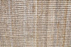 Beschaffenheits-Hintergrund einer Brown-Gewebe-Fußmatte Lizenzfreies Stockfoto