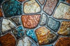 Beschaffenheitsalte Steinfliese Stockbild