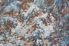 Beschaffenheitshintergrund des Felsengranitsteins Stockbilder