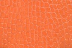 Beschaffenheitshintergrund des prägeartigen Leders der Orange Stockfotos