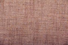 Beschaffenheitshintergrund des Sackleinens des groben Sackzeugs gesponnener Leinwand/Baumwollgewebeshintergrund mit Flecken von u stockbild