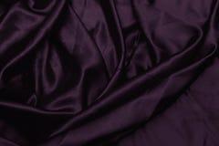 Beschaffenheitssatin Silk Hintergrund glänzendes Segeltuch des gewellten Profils Farbgewebe, Stoffpurpur Lizenzfreie Stockfotografie