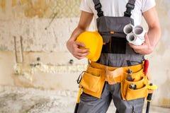 Beschermend toestel, werkende hulpmiddelen, projecten en een helm royalty-vrije stock fotografie