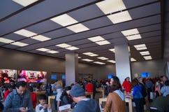 Beschäftigter Apfelspeicher Stockbilder