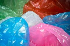 Beschikbare plastic zakkenachtergrond Lichtgewicht transparant, opnieuw te gebruiken plastic afval Vuilniszakken, plastic recycli royalty-vrije stock afbeelding