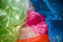 Beschikbare plastic zakkenachtergrond Lichtgewicht transparant, opnieuw te gebruiken plastic afval Vuilniszakken, plastic recycli royalty-vrije stock afbeeldingen