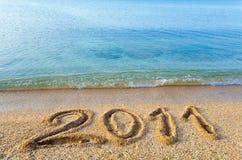 Beschreibung 2011 auf sandigem Strand Lizenzfreie Stockfotografie