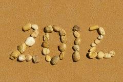 Beschreibung 2012 auf dem goldenen Sand Stockbild