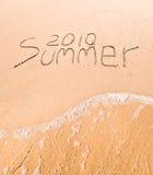 Beschreibung auf nassem Sand Stockfoto