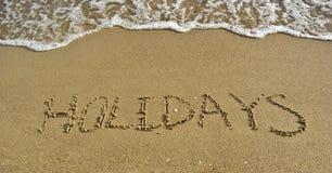 Beschreibung-Feiertage auf einem Sand Stockbild