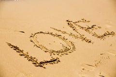 Beschreibung-Liebe auf einem Sand stockfotos