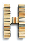 Beschriften Sie H, das von den Seitenenden von Büchern gebildet wird Lizenzfreies Stockfoto