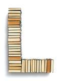 Beschriften Sie L, das von den Seitenenden von Büchern gebildet wird Lizenzfreie Stockfotografie
