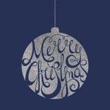 Beschriften von frohen Weihnachten im silbernen Ball Stockfotografie
